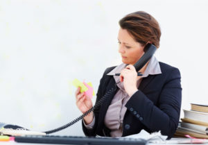 Woman on phone working at desk